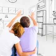 image of couple planning furniture for home